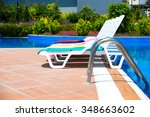 sun chairs at the pool | Shutterstock . vector #348663602