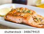 Stock photo grilled salmon with garlic and herb by lemon 348679415