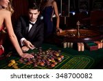 handsome man playing in casino | Shutterstock . vector #348700082
