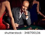 handsome man playing in casino | Shutterstock . vector #348700136