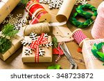 wrapping christmas gifts in... | Shutterstock . vector #348723872