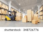 Forklift Truck In Warehouse. 3...