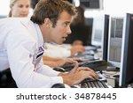 businessman using computer | Shutterstock . vector #34878445