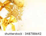 gift box with golden ribbon and ... | Shutterstock . vector #348788642