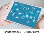 hand holding modern tablet....   Shutterstock . vector #348801896