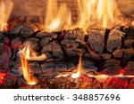 Burning Log Of Wood In A...