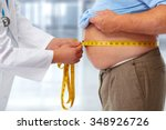 doctor measuring obese man... | Shutterstock . vector #348926726