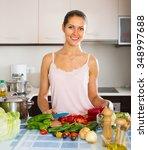 happy female preparing healthy... | Shutterstock . vector #348997688