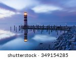 a lighthouse reflected in a... | Shutterstock . vector #349154285