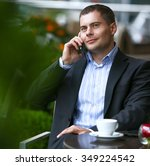 young businessman talking on a... | Shutterstock . vector #349224542
