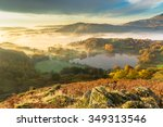 Stock photo autumn fog lingering over loughrigg tarn in the english lake district 349313546