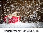 red gift box on snow with... | Shutterstock . vector #349330646