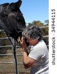 female trainer hugs muzzle of... | Shutterstock . vector #34944115