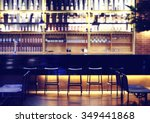 Stock photo interior of a modern pub or bar at night 349441868