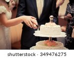 the bride and groom cut the... | Shutterstock . vector #349476275
