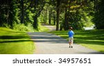 boy walking at the park | Shutterstock . vector #34957651