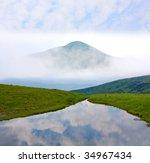 Mountain lake at morning - stock photo