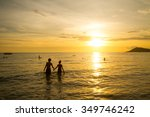 people walk in sea sunset | Shutterstock . vector #349746242