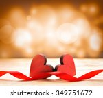 two wooden hearts and red... | Shutterstock . vector #349751672
