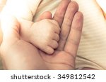 baby hand clenched into a fist | Shutterstock . vector #349812542