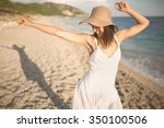 carefree woman dancing in the... | Shutterstock . vector #350100506