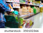 man pushing shopping cart full... | Shutterstock . vector #350102366