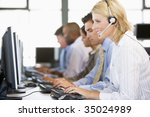 stock traders with headsets at... | Shutterstock . vector #35024989