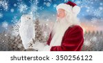 father christmas holds an owl... | Shutterstock . vector #350256122