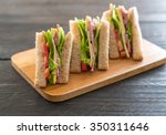 sandwich  on wood background | Shutterstock . vector #350311646