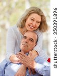 nice aged couple hugging each... | Shutterstock . vector #350391896