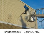 cleaning a wall with a water... | Shutterstock . vector #350400782