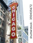 Small photo of Chicago Theater, formerly the Balaban and Katz Chicago Theater in Chicago, Illinois. The word Chicago is written on a red board. Skyscrapers are seen on the background.