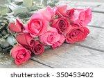 vintage rose on wooden table   Shutterstock . vector #350453402