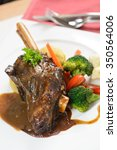 Small photo of Braised lamb shank in restaurant