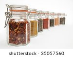 Row Of Spice Jars Containing...