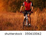 biker on the forest road riding ... | Shutterstock . vector #350610062