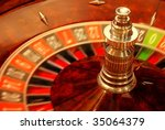 Close up of casino roulette in motion - stock photo