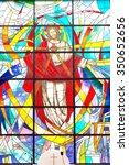 Small photo of Rocca di Papa, Italy - circa June 2015 - Modern colorful stained glass window with Jesus Christ and Sacred Heart, Divine Mercy in a parish church