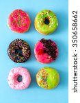 donuts glazed with sprinkles on ... | Shutterstock . vector #350658662