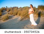 pregnant woman on beach at... | Shutterstock . vector #350734526