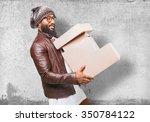 black man holding boxes | Shutterstock . vector #350784122