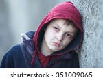 Stock photo dramatic portrait of a little homeless boy poverty city street 351009065