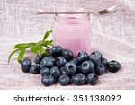 yogurt and blueberries on pink... | Shutterstock . vector #351138092