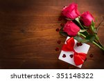 Roses And Gift On Wooden Board...