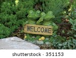 Two Frogs Holding A Welcome Sign