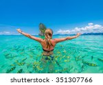 Woman Swimming With Snorkel...