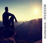 man tourist sit on peak of... | Shutterstock . vector #351323108