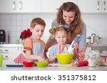 happy family preparing cookies... | Shutterstock . vector #351375812