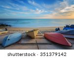 Three Colorful Boats Resting O...