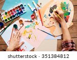 artist hands painting with